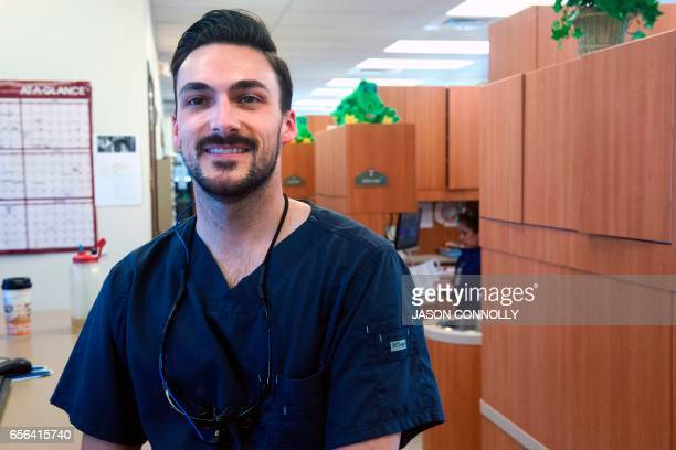 Dr Luke Johnson poses for a portrait at Inner City Health Center in Denver Colorado on March 15 2017 Dr Johnson has been working as one of three...