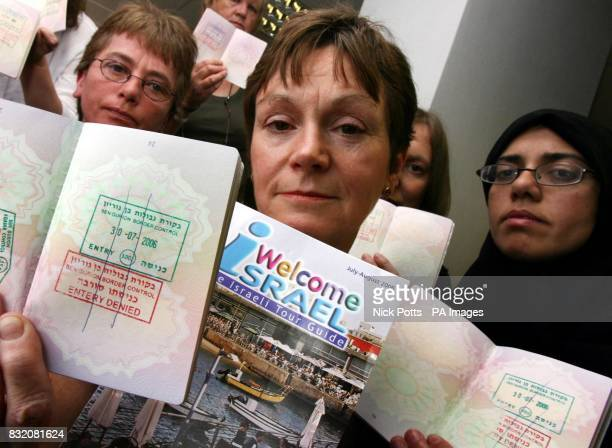 Dr Lynne Jones MP and Tahra Bibi surrounded by the other British women who were part of a group who were yesterday deported from Israel while on a...