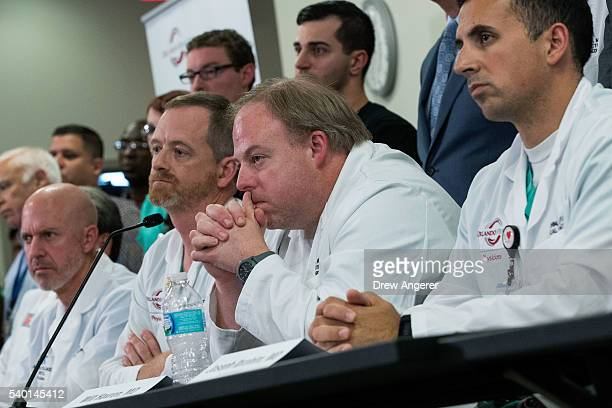 Dr Marc Levy Dr Michael Cheatham Dr Will Havron and Dr Joseph Ibrahim listen to questions during a press conference at Orlando Regional Medical...