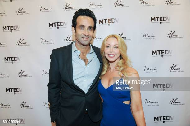 Dr Marc Mani and Darnell Cox attend A Night Out a fundraising event benefiting #MoveToEndDV hosted by Beverly Hills plastic surgeon Dr Marc Mani at...