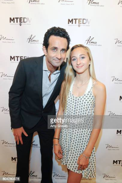 Dr Marc Mani and his daughter Erica attend A Night Out a fundraising event benefiting #MoveToEndDV hosted by Beverly Hills plastic surgeon Dr Marc...