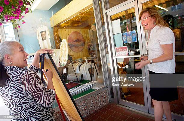 MARCIBOWERSTRINIDAD COLORADO JUNE 6 2007 Dr Marci Bowers is greeted by Carole <cq> McKee <cq> a sales clerk for the Eagle Totem Village Gallery and...