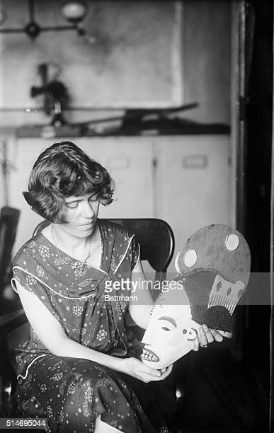 Dr Margaret Mead assistant curator at the American Museum of Art holds a mask