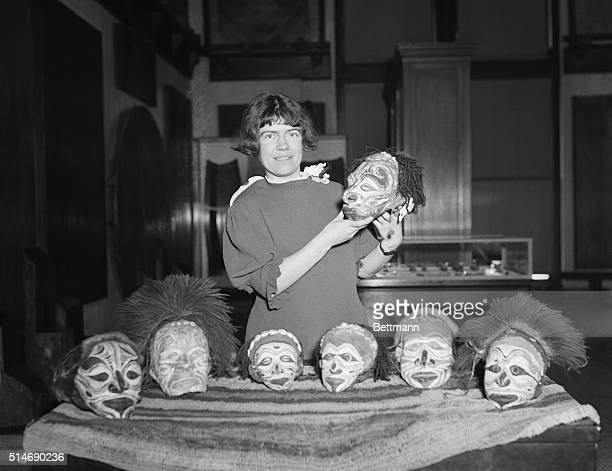 Dr Margaret Mead Assistant Curator of Ethnology at the American Museum of Natural History displays some of the trophy heads that she brought back...