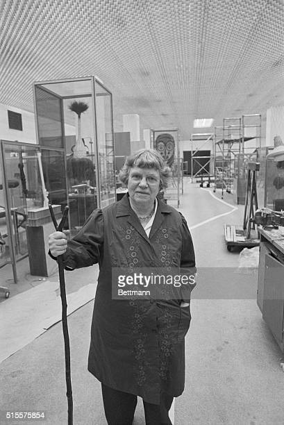 Dr. Margaret Mead stands among the cultural exhibits of Oceania being installed in the American Museum of Natural History. She wrote over a dozen...