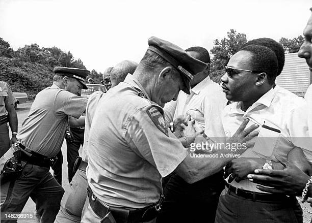 Dr Martin Luther King being shoved back by Mississippi patrolmen during the 220 mile 'March Against Fear' from Memphis Tennessee to Jackson...