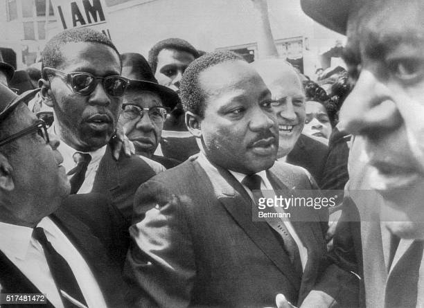 Dr Martin Luther King is surrounded by leaders of the sanitation strike here as he arrived to lead a march in support of the striking workers Shortly...