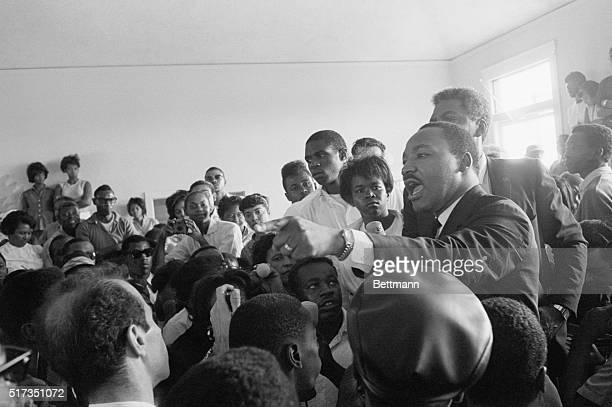 "Dr. Martin Luther King, Jr. Addresses a group of Watts district residents and tells them he is ""here to support you because you supported me in the..."