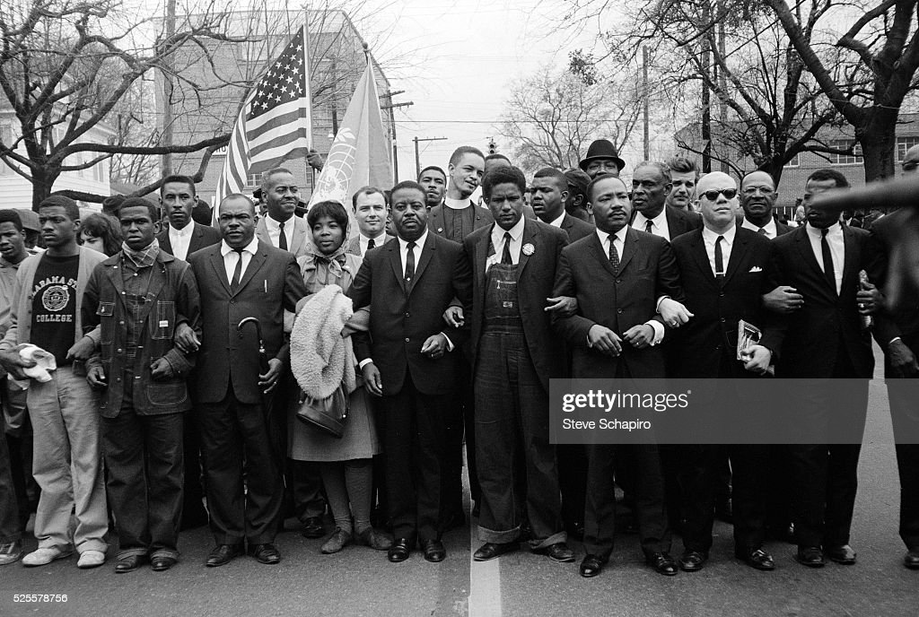 Dr. Martin Luther King, Jr. and group of marchers enter Montgomery at the end of the Selma to Montgomery Civil Rights March.