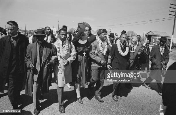 Dr Martin Luther King Jr arm in arm with Reverend Ralph Abernathy leads marchers as they begin the Selma to Montgomery civil rights march from...