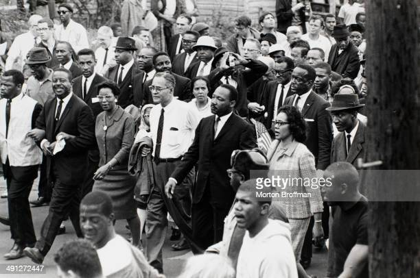 Dr. Martin Luther King, Jr. arrives in Montgomery at the culmination of the Selma to Montgomery March, 25th March 1965. Pictured from left are John Lewis, Rev. Ralph Abernathy, Juanita Abernathy, Ralph Bunche, Dr. Martin Luther King, Jr., Coretta Scott King, Rev. Fred Shuttlesworth (wearing hat).