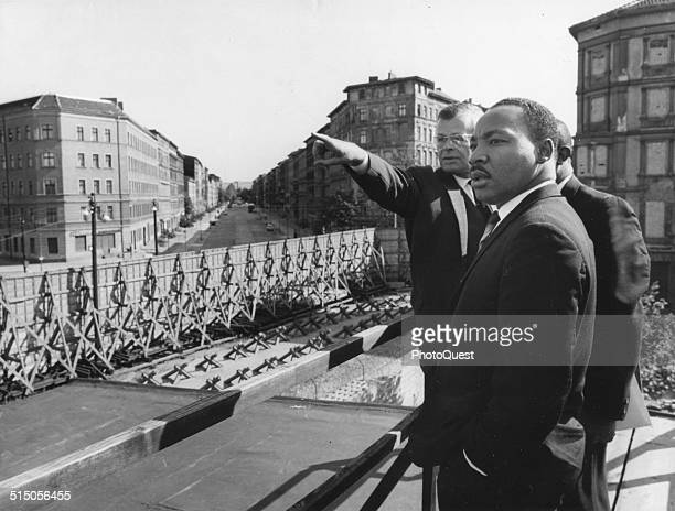 Dr Martin Luther King Jr at the Soviet Sector border of the Berlin Wall in Bernauer Strasse Berlin Germany September 12 1964 Werner Steltzer director...