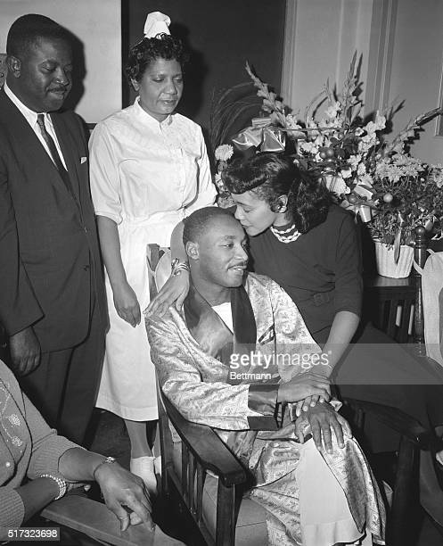 Dr. Martin Luther King Jr. Is comforted by his wife in Harlem Hospital after he was stabbed in the chest while at a book signing in Harlem, New York...