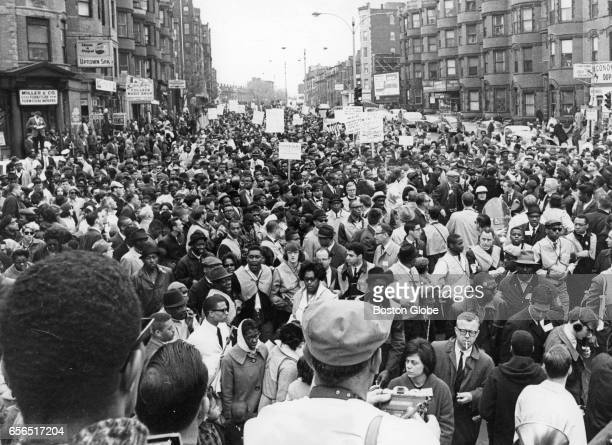 Dr. Martin Luther King Jr. Leads the mile-long column of marchers walking from Roxbury to Boston Common on Apr. 23, 1965. The march left the Carter...