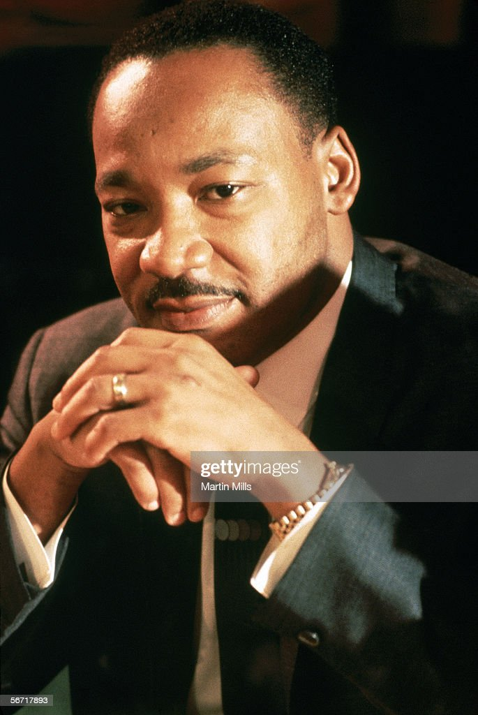 Dr. Martin Luther King Jr. sits with his hands folded for a portrait circa 1967.