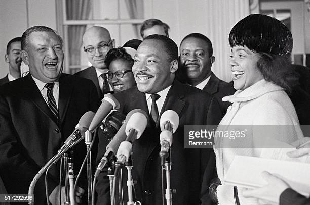 Dr Martin Luther King Jr winner of the Nobel Peace Prize and his wife Coretta laugh with reporters at a press conference after the Kings' visit to...