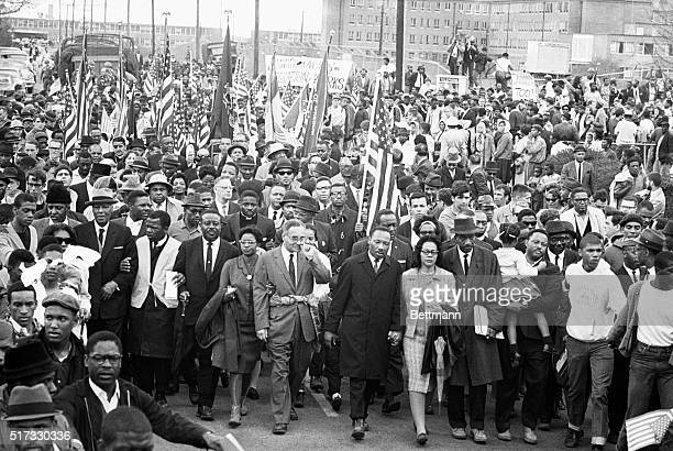 Dr Martin Luther King Jr with John Lewis of SNCC King's aide Rev Ralph Abernathy Dr Ralph Bunche Mrs King and Rev Hosea Williams arrive in Montgomery...