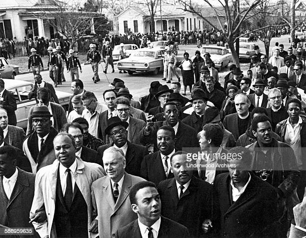 Dr Martin Luther King leads a voter protest march Selma Alabama March 9 1965 Behind him is Reverend Ralph D Abernathy and King's aide Andrew Young is...