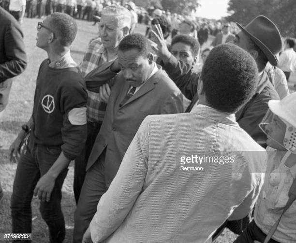 Dr Martin Luther King rubs his head after being hit by a rock as he led a group of marchers through an allwhite neighborhood protesting alleged...