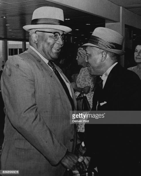 Dr Martin Luther King Sr left is greeted Upon his Arrival in Denver Among welcoming party at Stapleton International Airport was the Rev John Morris...