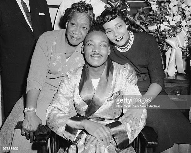 Dr Martin Luther King with his mother and his wife Coretta are smiling and cheerful druing their interview yesterday in Harlem Hospital after being...