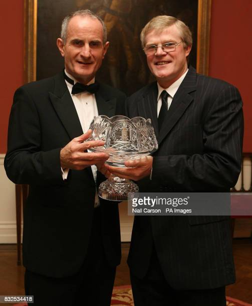 Dr Martin McAleese husband of Irish President Mary McAleese presents De La Salle priest Brother Tom Walsh with the Allianz Education Award