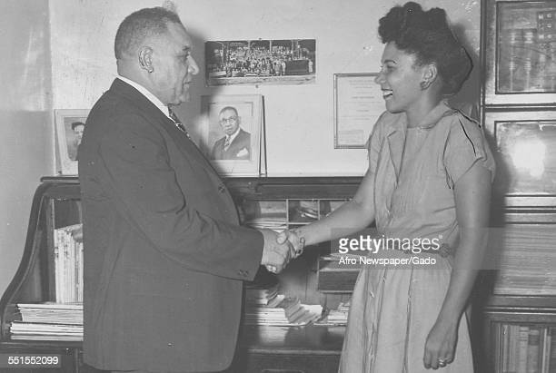 Dr Martin owner of the Red Sox baseball team shaking hands with Mrs Bankhead wife of the pitcher Dan New York City June 9 1947