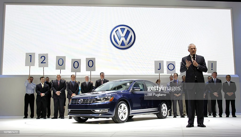 Dr. Martin Winterkorn, Chairman of Volkswagen Management Group (R) introduces the new Volkswagen Passat at the 2011 North American International Auto Show January 10, 2011 in Detroit, Michigan. Approximately 4500 journalists from over 60 countries are attending the NAIAS, which features more than 30 worldwide debuts of vehicles by automotive manufacturers from around the world.