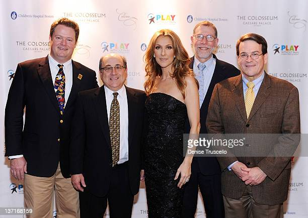 Dr Matthew Heeney Dr Stu Orkin Celine Dion Dr Gary Fleisher and Dr Dave Williams pose for photos backstage before Celine Dion's performance to...