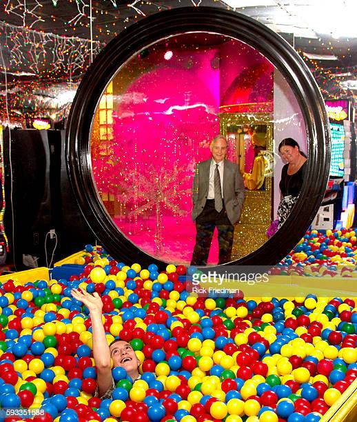 Dr Matthew Israel Executive Director of the Judge Rotenberg Center and staff member Glenda Crookes view a student in the Game Room as a reward for...