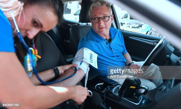 Dr Matthew Mullarky has his vitals checked by emergency department nurse Christa Mirabal in front of St Joseph's hospital in Orange California on...