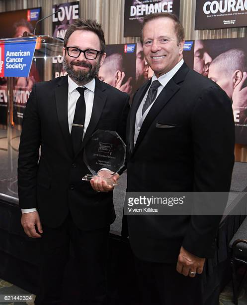 Dr Matthew Pratt accepts award from Executive Vice President and California Division Operating Officer for American Cancer Society David F Veneziano...