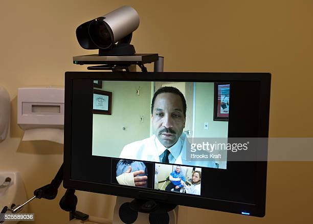 Dr Maurice Cates Orthopedic Surgeon conducts a live Orthopedic consultation remotely by video with a patient at Kaiser Permanente's Capitol Hill...