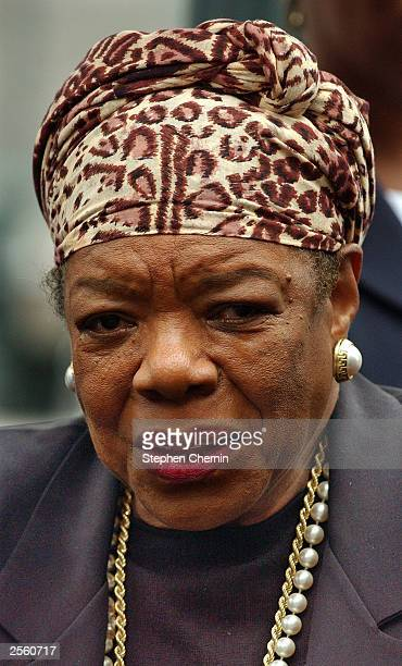 Dr Maya Angelou a poet author and civilrights activist leaves the stage after she addressed the crowd during the reinterment ceremony at the African...