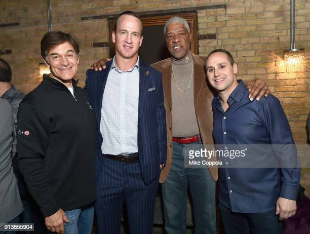Dr Mehmet Oz former NFL player Peyton Manning former NBA player Julius 'Dr J' Erving and Fanatics Founder/Executive Chairman Michael Rubin at the...