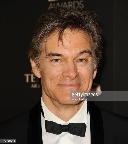 Dr Mehmet Oz poses in the press room at the 40th annual Daytime Emmy Awards at The Beverly Hilton Hotel on June 16 2013 in Beverly Hills California