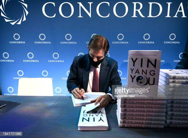 """Dr. Mehmet Oz, Professor of Surgery, Columbia University signs copies of his """"Yin Yang You"""" book during the 2021 Concordia Annual Summit - Day 2 at..."""