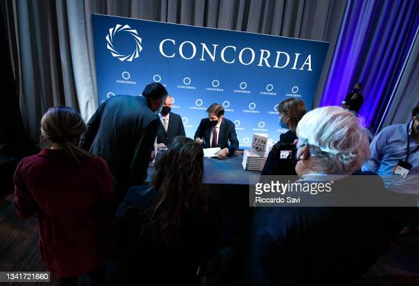 """Dr. Mehmet Oz , Professor of Surgery, Columbia University, signs copies of his """"Yin Yang You"""" book during the 2021 Concordia Annual Summit - Day 2 at..."""