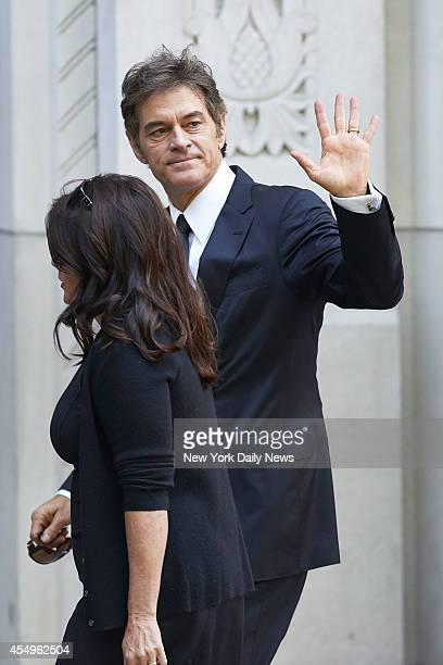 Dr Mehmet Oz with his wife Lisa arrives before a funeral service for comedienne Joan Rivers at Temple EmanuEl on Sunday September 7 2014 in New York...