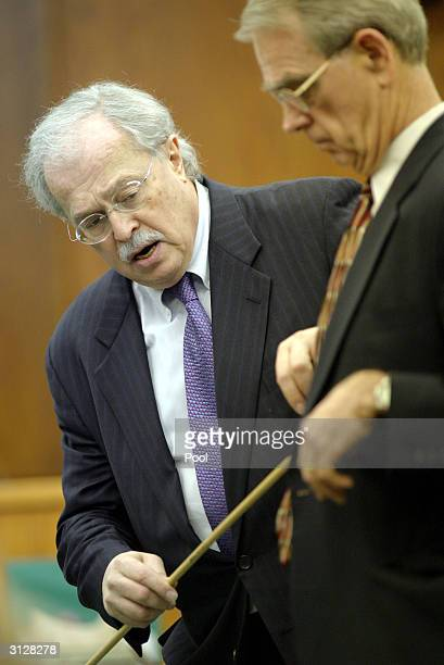Dr Michael Baden shows the shotgun trajectory to Joseph Hayden Jayson Williams attorney March 24 2004 in Somerville New Jersey during the...