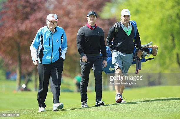 Dr Michael Smurfit the owner of The K Club and Rory McIlroy of Northern Ireland walk together alongside caddie JP Fitzgerald during practice for the...