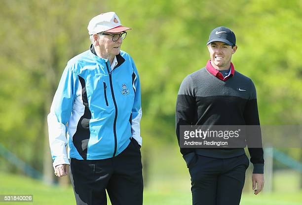 Dr Michael Smurfit the owner of The K Club and Rory McIlroy of Northern Ireland walk together during practice for the Dubai Duty Free Irish Open...