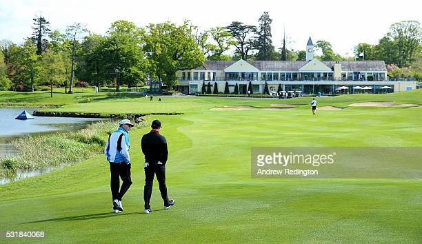 Dr Michael Smurfit the owner of The K Club and Rory McIlroy of Northern Ireland walk together on the 18th hole during practice for the Dubai Duty...
