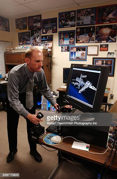 Dr Michael Wright demonstrates a virtual reality computer program that simulates docking of the International Space Station and the Space Shuttle...