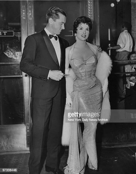 Dr Milko Skofic with wife Italian actress Gina Lollobrigida attending opening of the movie The Barefoot Contessa at the Capitol Theater