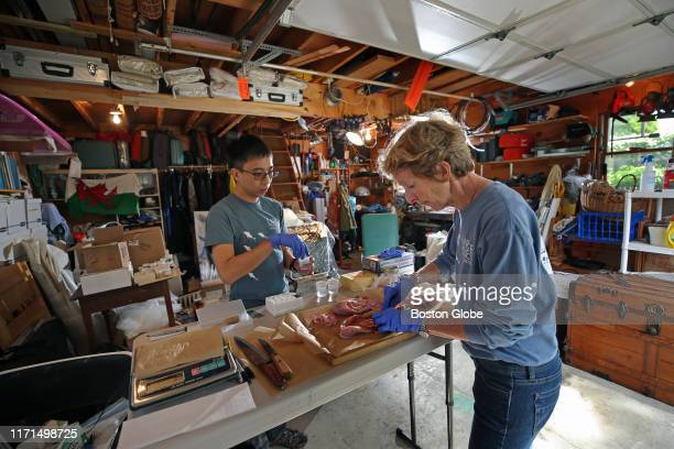 Dr Molly Lutcavage and assistant research professor Chi Hin Lam do scientific research on gonads from tuna in Lutcavage's garage lab at her home in...