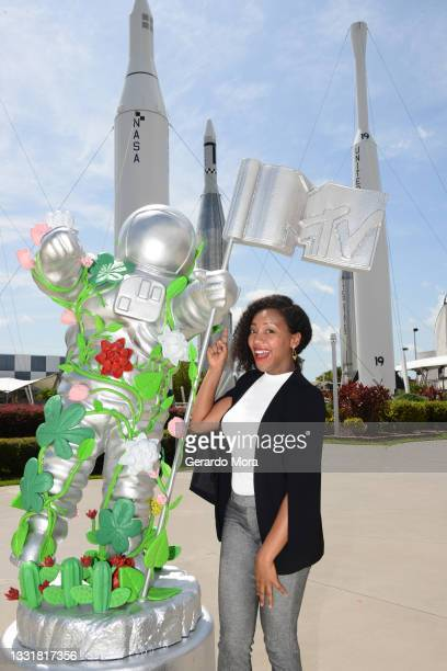 Dr. Moogega Cooper, Planetary Protection Lead, Mars 2020 Mission poses as MTV unveils special edition large-scale Moon Person at Kennedy Space Center...