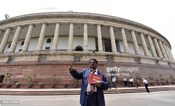 Dr N Siva Prasad MP poses as Dr Bhimrao Ambedkar outside Parliament during the Parliament Session at Parliament House on May 9 2016 in New Delhi...