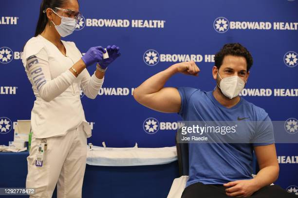 Dr. Nadav Fields, DO., internal medicine, Broward Health Imperial Point, reacts after receiving a shot of the Moderna COVID-19 vaccine from Leonida...