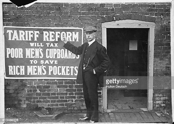 Dr Napier the Liberal party candidate for north east Kent in the 1910 election beside a campaign poster against tariff reform